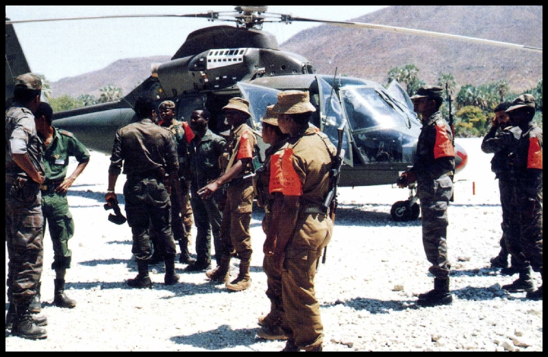 http://www.sadf.info/SWATF%20Pics/Members%20of%20the%20JMMC%20at%20a%20Cuban%20Helicopter.jpg